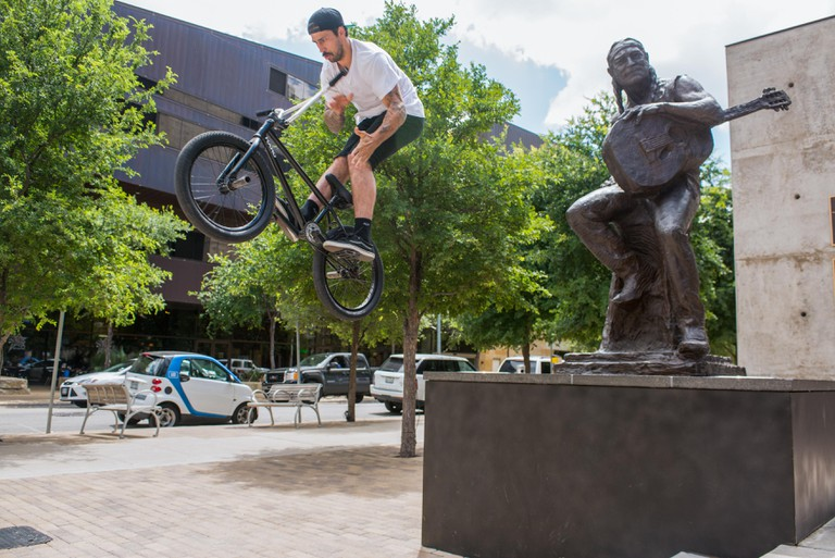 SETH KLINGER barspins off a ledge next to Austin's country icon WILLIE NELSON.