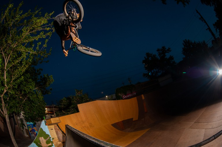 Terrible One BMX owner/rider JOE RICH rips a kickout at the TI Ramp compund.