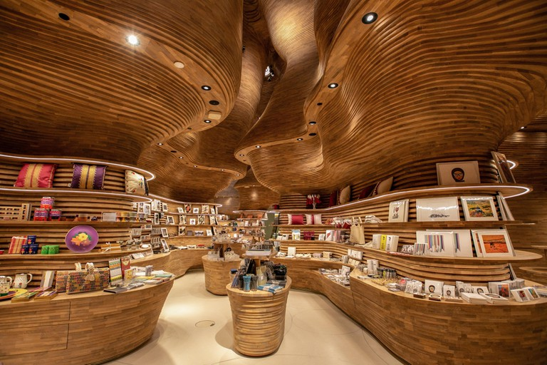 Doha, Qatar. 27th Mar, 2019. A general view shows the gift shop of the new National Museum of Qatar designed by architect Koichi Takada on it's opening day. Sydney-based Takada has designed six interiors in the museum. Credit: Sharil Babu/dpa/Alamy Live N