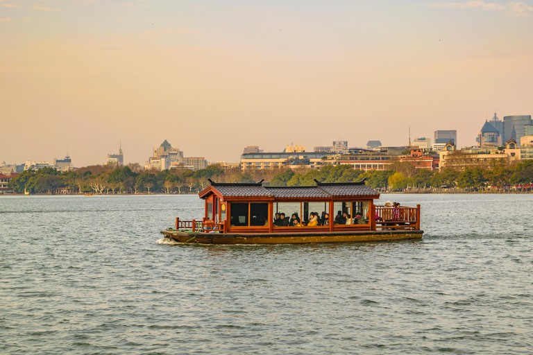 Touristic traditional boat at west lake in Hangzhou City