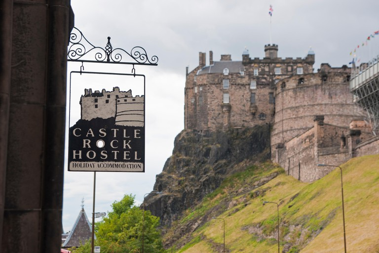 Emblem of the Castle Rock Hostel with the castle out of focus in the background.