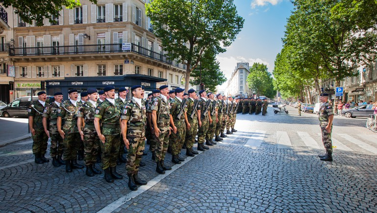 French Military shout loudly whilst on Parade on Bastille Day, in Paris, France