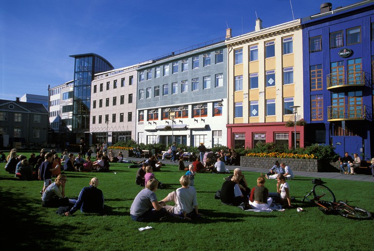 People chatting and enjoying summer in Reykjavik city center square