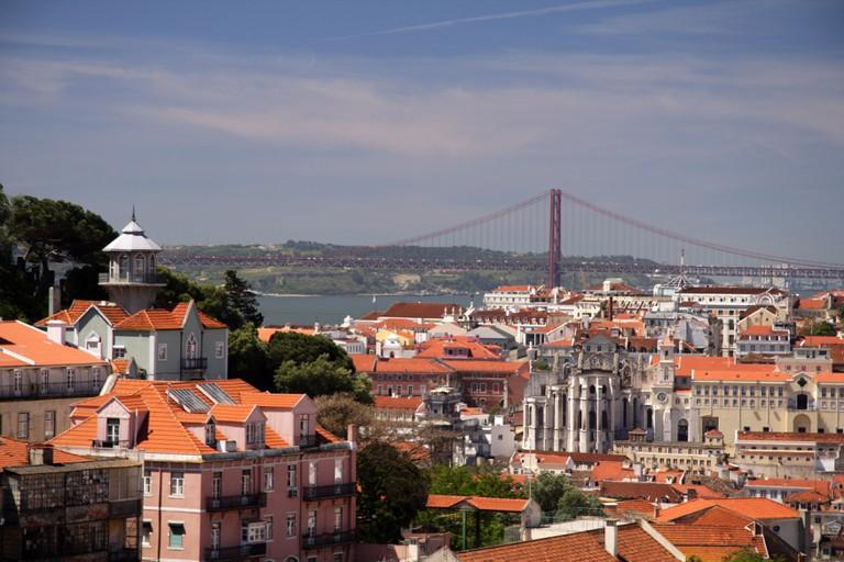 City view from Miradouro da Graca with the Ponte 25 De Abril Bridge in the background.