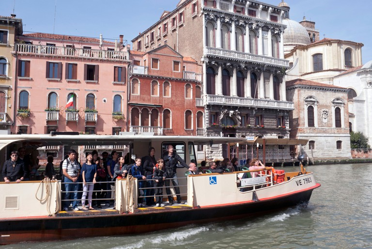 A crowded vaporetto on the Grand Canal in Venice, Italy.