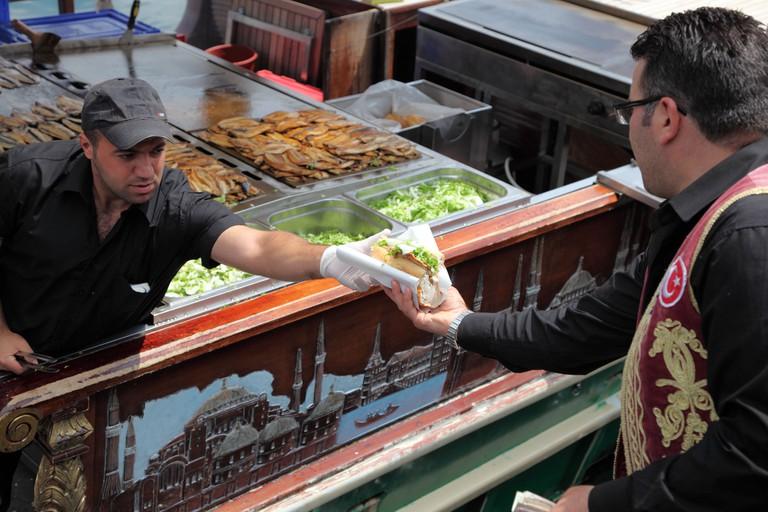 Turkish fast food - Balik Ekmek (fish in bread) in Istanbul, Turkey