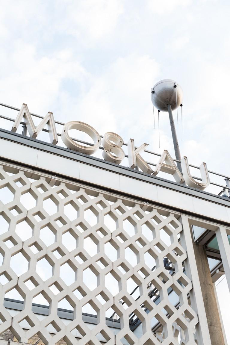 A life-size replica of the Sputnik 1 satellite sits atop Café Moskau