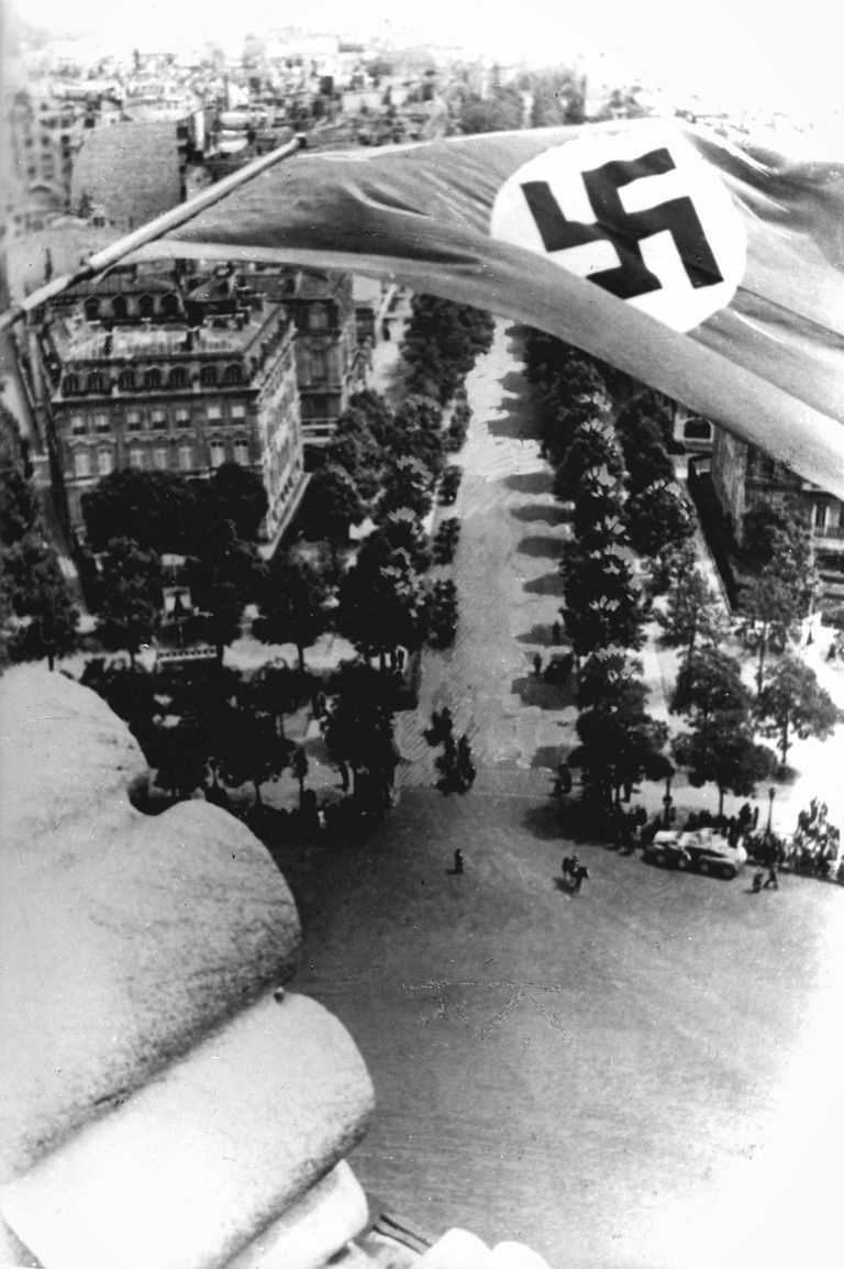 World War 2:  German occupation of Paris, June 1940. The German flag flying from the Arc de Triomphe