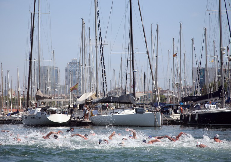 People swimming at an Open Water event in Barcelona.