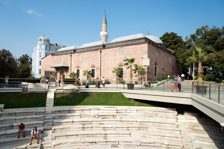 The curved part of the the Stadium of Philippopolis and the Dzhumaya Mosque, Plovdiv, Bulgaria