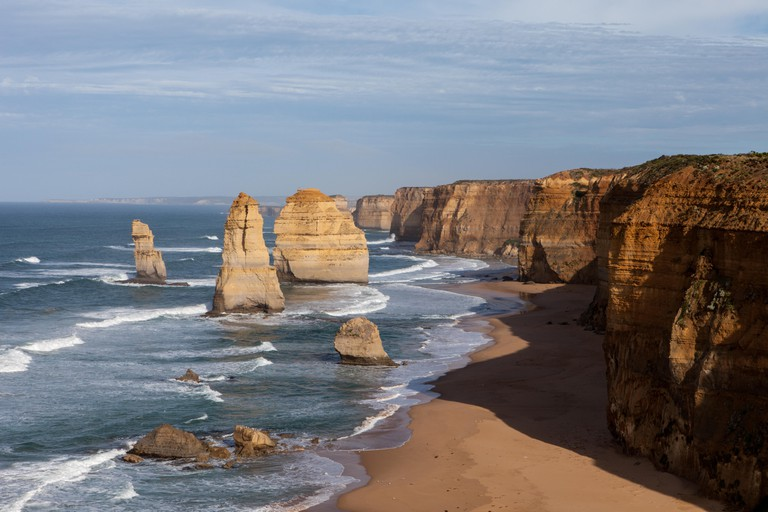 The Twelve Apostles is a collection of limestone stacks off the shore of the Port Campbell National Park, by the Great Ocean Road