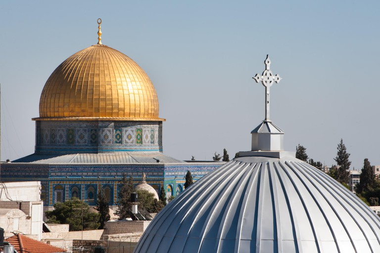 Our Lady of the Spasm Armenian Catholic Church and the Dome of the Rock in the Old City of Jerusalem.