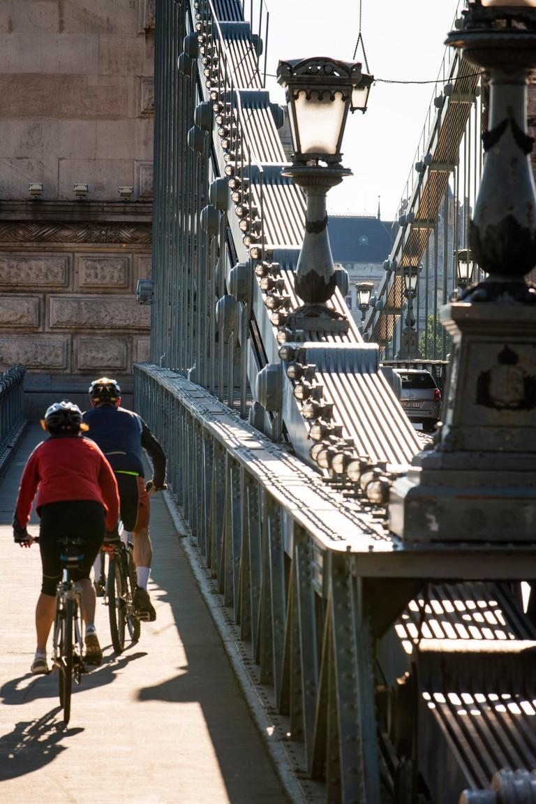 Cycling over Szechenyi chain bridge, Budapest.