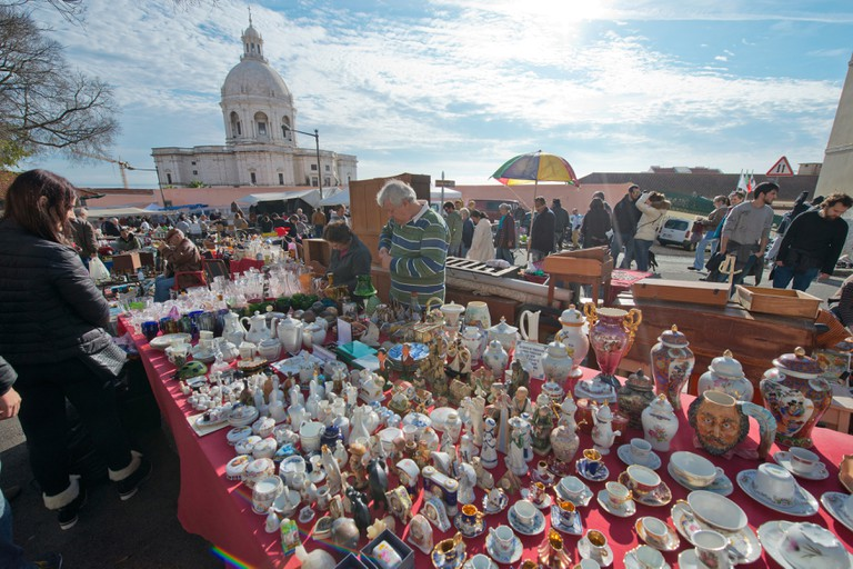 Feira da ladra, a flea market held twice weekly attracting locals and tourists in Alfama, Lisbon, Portugal.