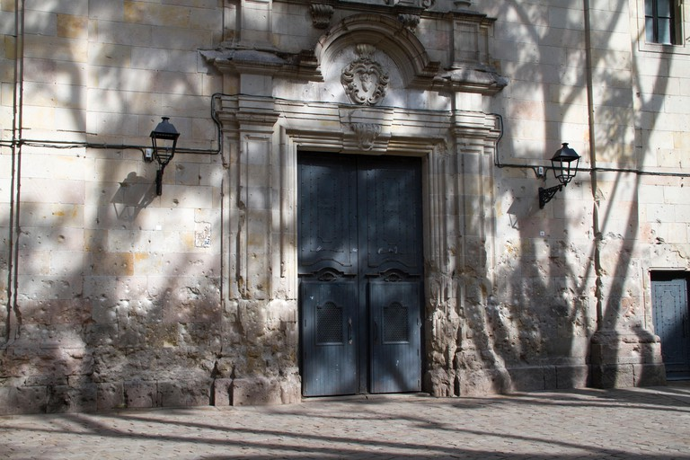 Walls of church in the Old City pockmarked with bullet holes from the Spanish Civil War, Barcelona.