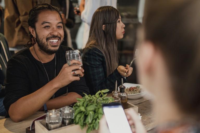 Friends Socialising in Bar
