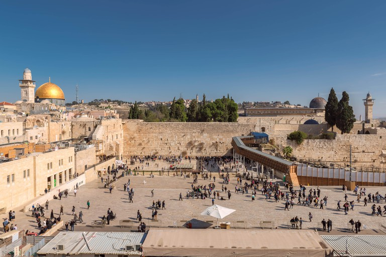 Western Wall and golden Dome of the Rock on Temple Mount, Jerusalem, Israel.