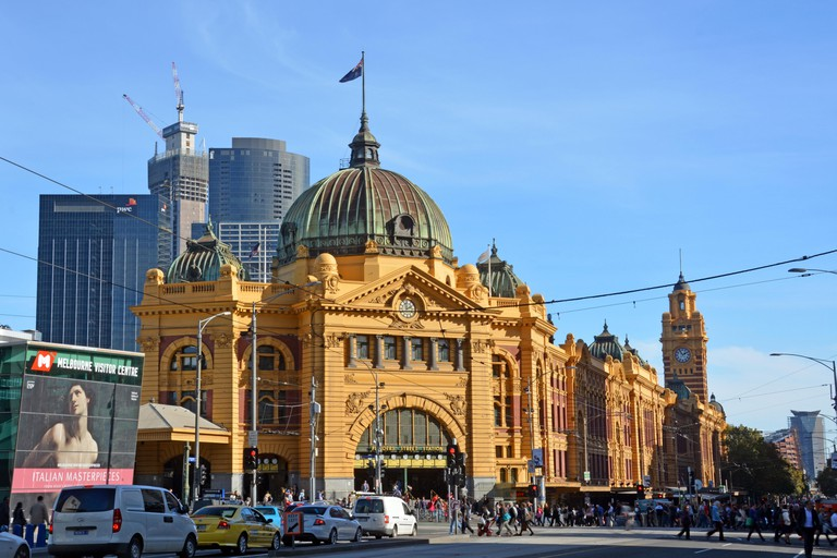 Melbourne, Australia - May 14, 2014: Historic Flinders Street Rail Station building on the banks of the Yarra River in Autumn.