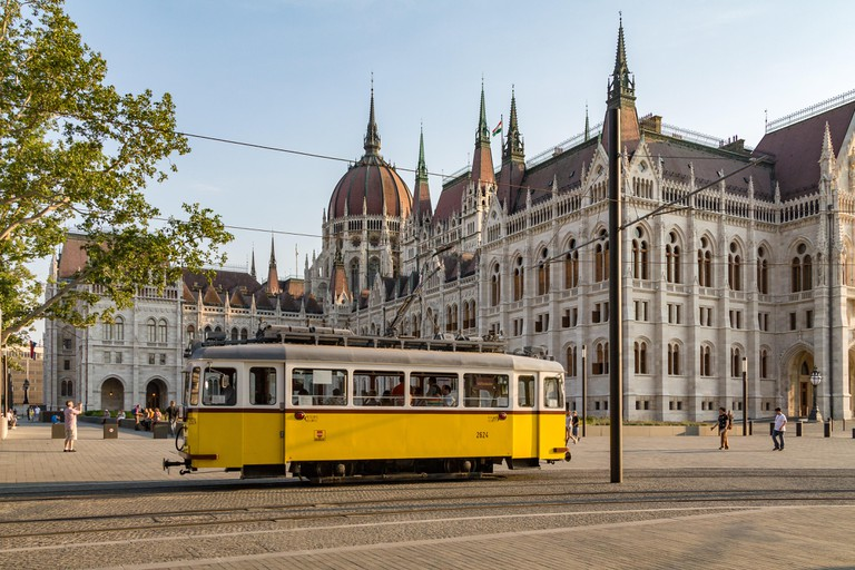 A classic tram in front of the Hungarian Parliament building in Budapest, Hungary
