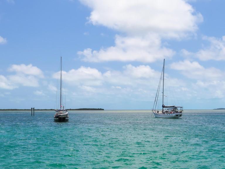 Sailboats anchored in the Bimini islands, Bahamas.