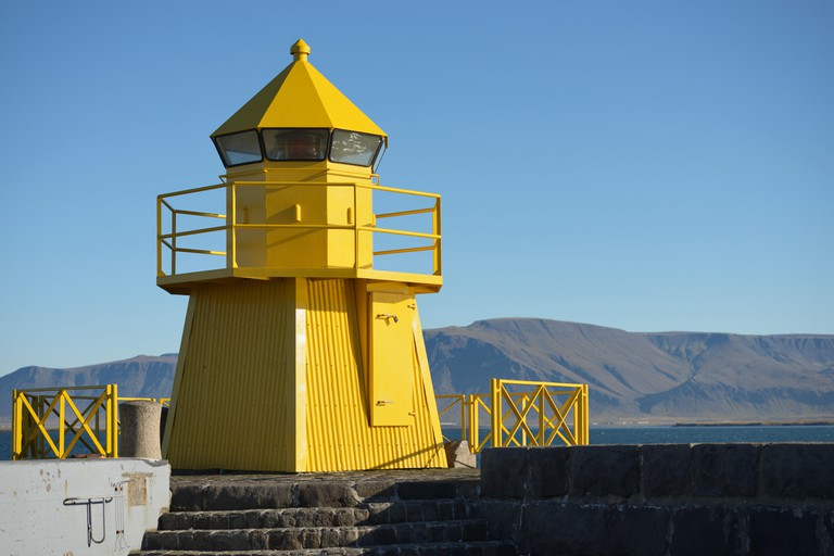 Yellow Lighthouse in the harbour entrance, Reykjavik, Iceland