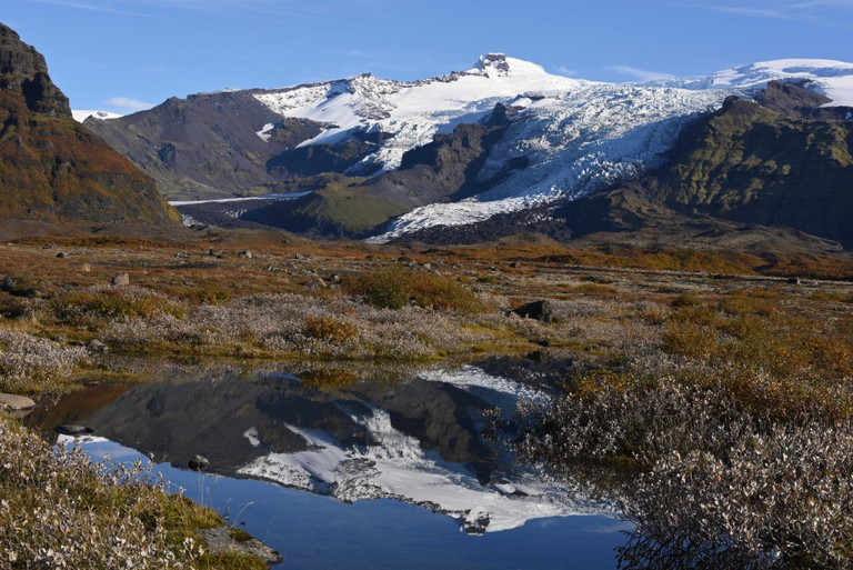 The beautiful Falljokull and Virkisjokull glaciers reflected in a pond in Vatnajokull National Park, Iceland.