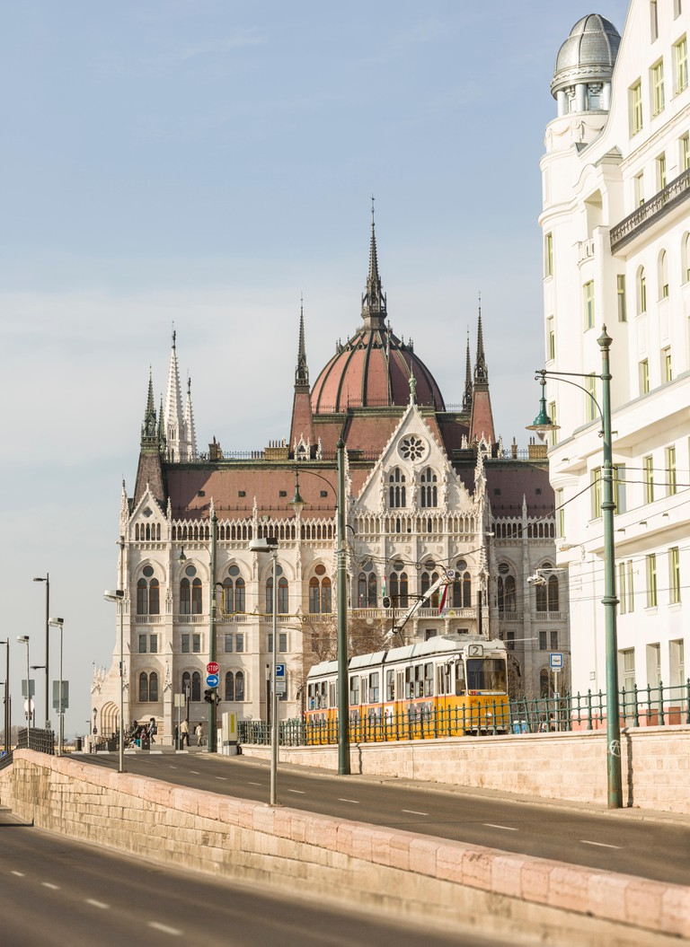 Tram outside the Hungarian Parliament Building in Budapest, Hungary.