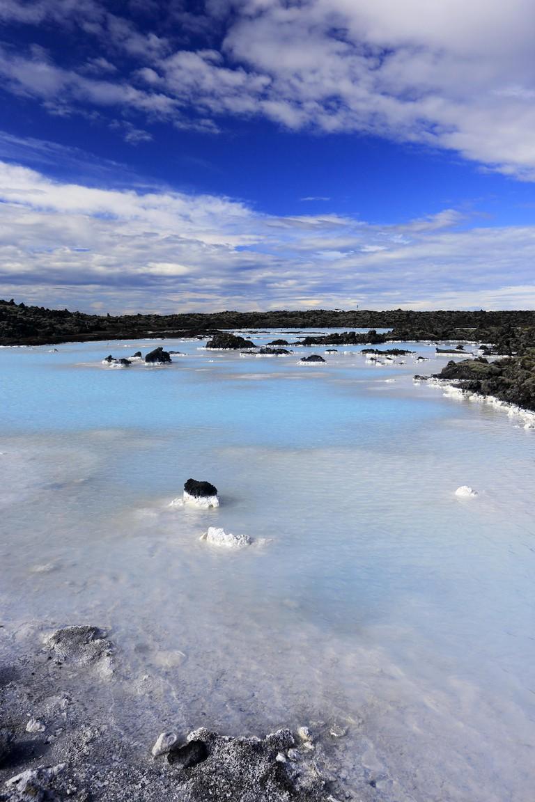 Volcanic rock formed Blue Lagoon landscape in Reykjanes Peninsula, Iceland.