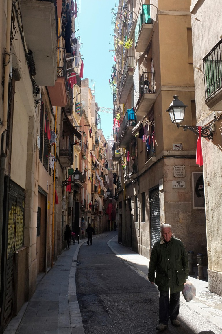 Winding streets of El Raval district of Barcelona, Spain