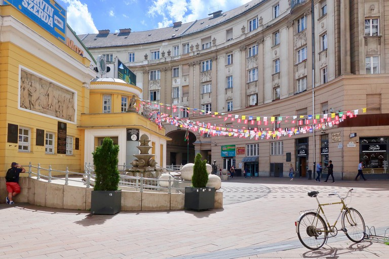 Budapest: Hot bright sunny spring day, April 2018. Art deco Corvin Mozi / cinema with bunting. District 8 / kerulet 8.