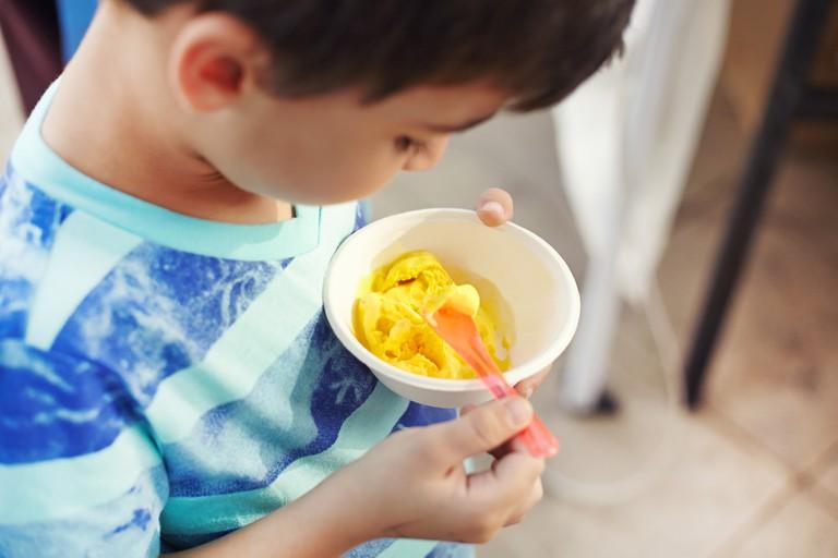 NOUQ Child Eating Saffron