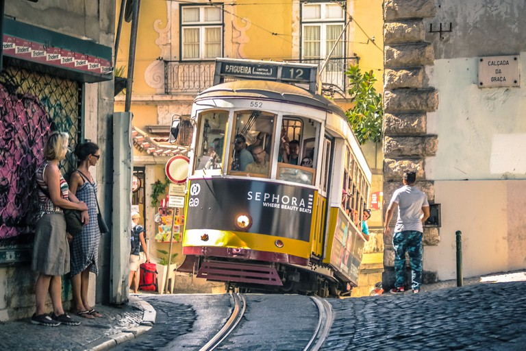 Lisbon. Famous old tram climbing uphill in Alfama.