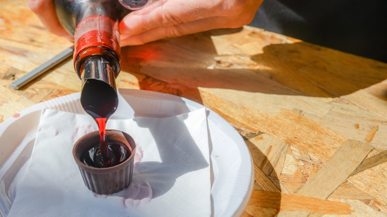 Ginja de Obidos, traditional sour cherry liquor, served in small cups made of chocolate.