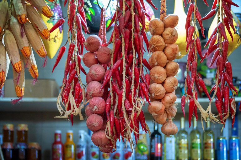 Dried paprikas and garlic strings at the Central market hall in Budapest, Hungary