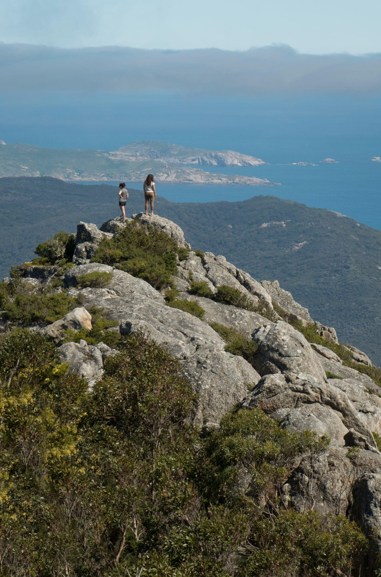 Two girls on the summit of mt Oberon, Wilsons Promontory National Park, Australia