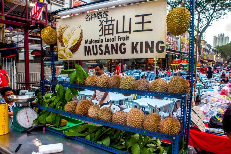 A Durian fruit stand on Jalan Alor, Food Street, in Bukit Bintang, Kuala Lumpur, Malaysia.