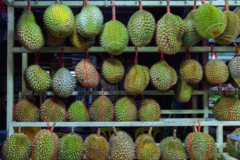 Whole durians - sales stand in Kuala Lumpur, Malaysia. The King of the fruit.