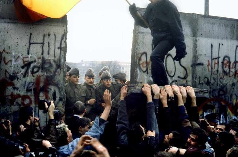 West Berliners break down a section of the Berlin Wall Berlin, Germany. On November 9, 1989