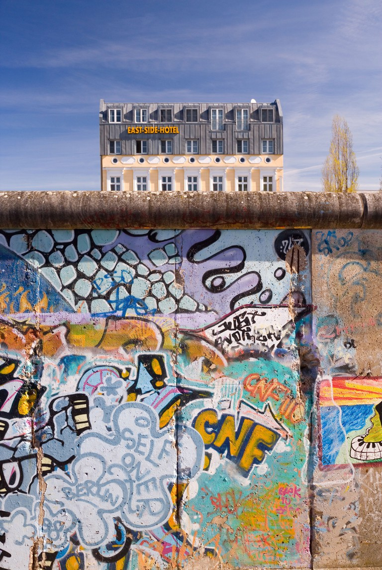 Former section of Berlin Wall, view from former West Berlin showing the East Side Hotel, Berlin, Germany