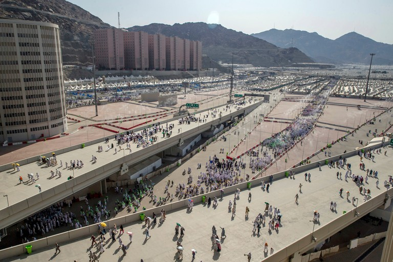 Muslim pilgrims walk towards Jamarat to cast stones at three huge stone pillars in the symbolic stoning of the devil during the annual hajj pilgrimage.