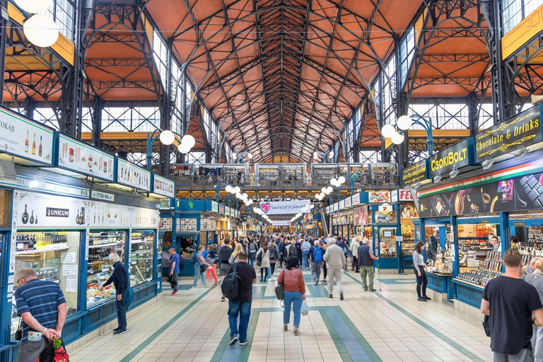 People shopping in the Great Market Hall in Budapest, Hungary. Great Market Hall is the largest indoor market in Bu