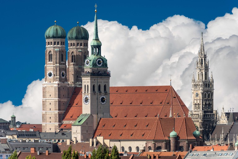 Cityscape of Munich with the Cathedral of Our Dear Lady (Frauenkirche), the church of Saint Peter and the New Town Hall (Neues Rathaus). Bavaria, Germ