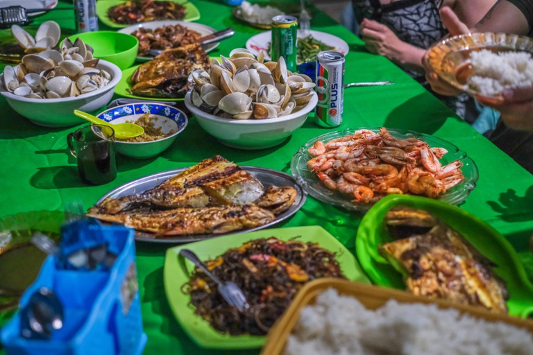 A feast of seafood served to the guests of Kampung Meruap, which has just opened to tourism to improve the livelihoods of its residents