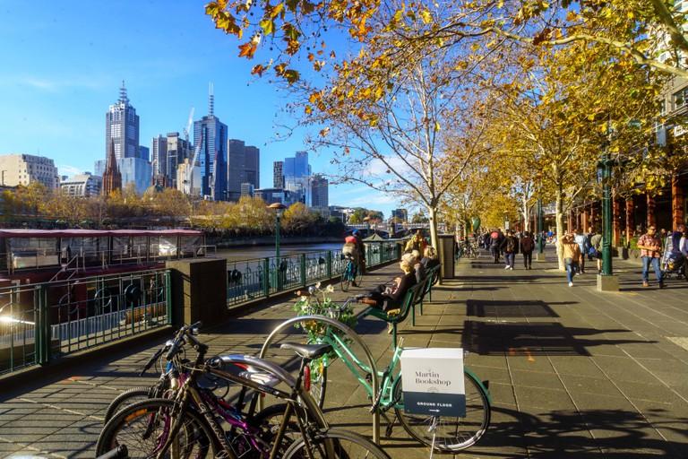 Boardwalk for shoppers on Southbank Yarra river side in Melbourne city CBD, Australia