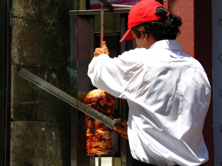 Slicing the döner from the rotisserie in Istanbul