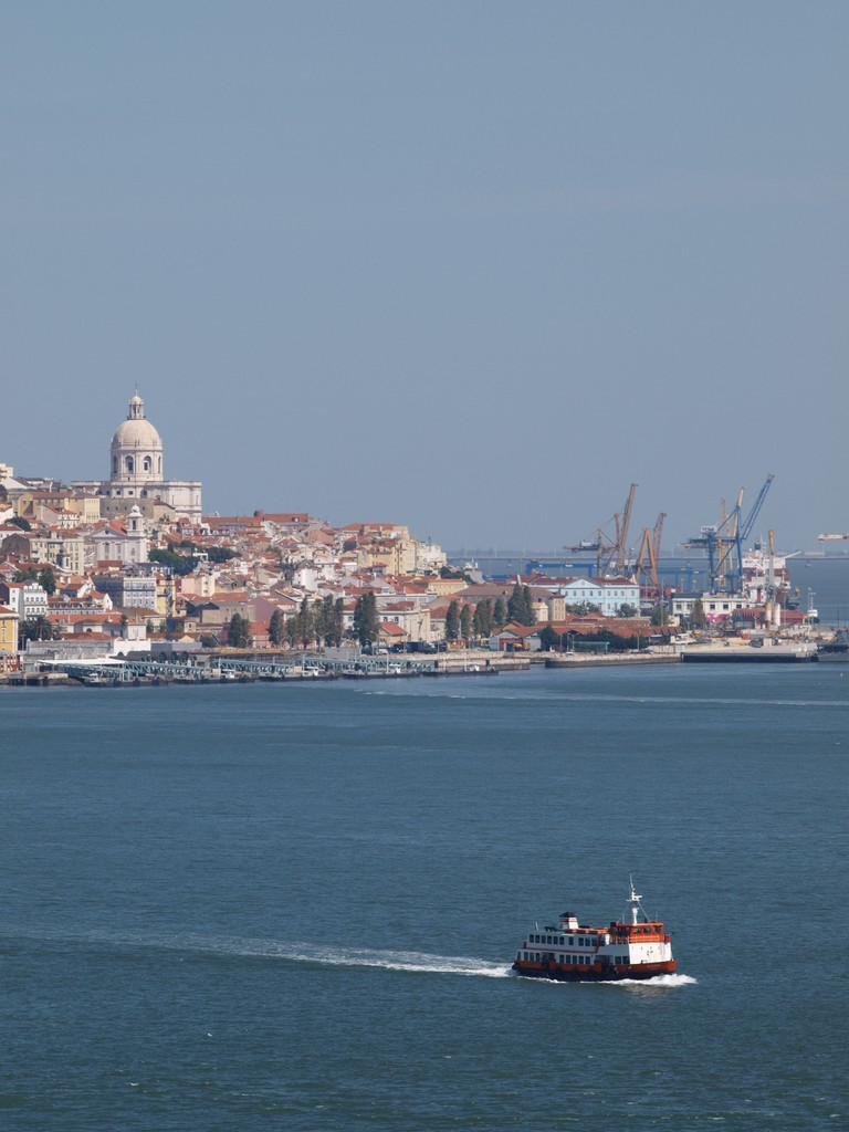 Cacilheiro (ferry boat) crossing the Tagus river