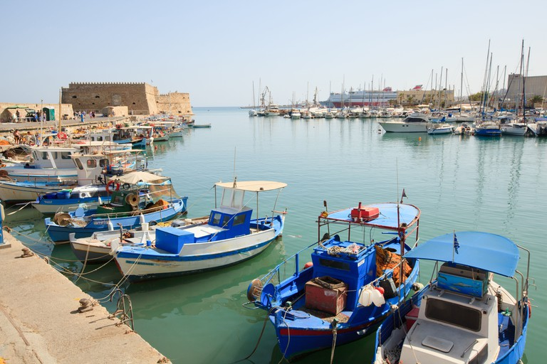 Venetian Fortress and fishing boats at Heraklion Harbour harbor, Crete