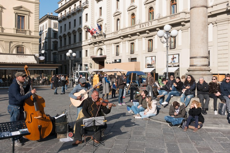 Musicians playing in the Piazza Della Republica, a popular square in Florence