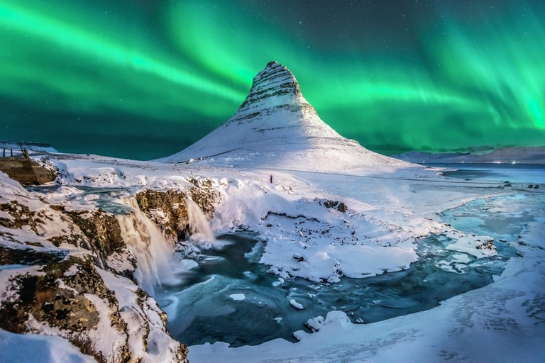 Northern lights above Mount Kirkjufell, Jokulsarlon lagoon, Iceland