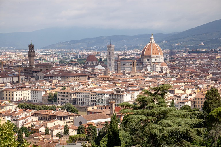 A view of Florence taken from the vantage point of San Miniato al Monte and focusing on: the historical centre,